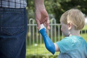 Child with prosthetic arm