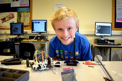 Boy with robot he has made