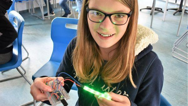 Girl holding electronic coding invention